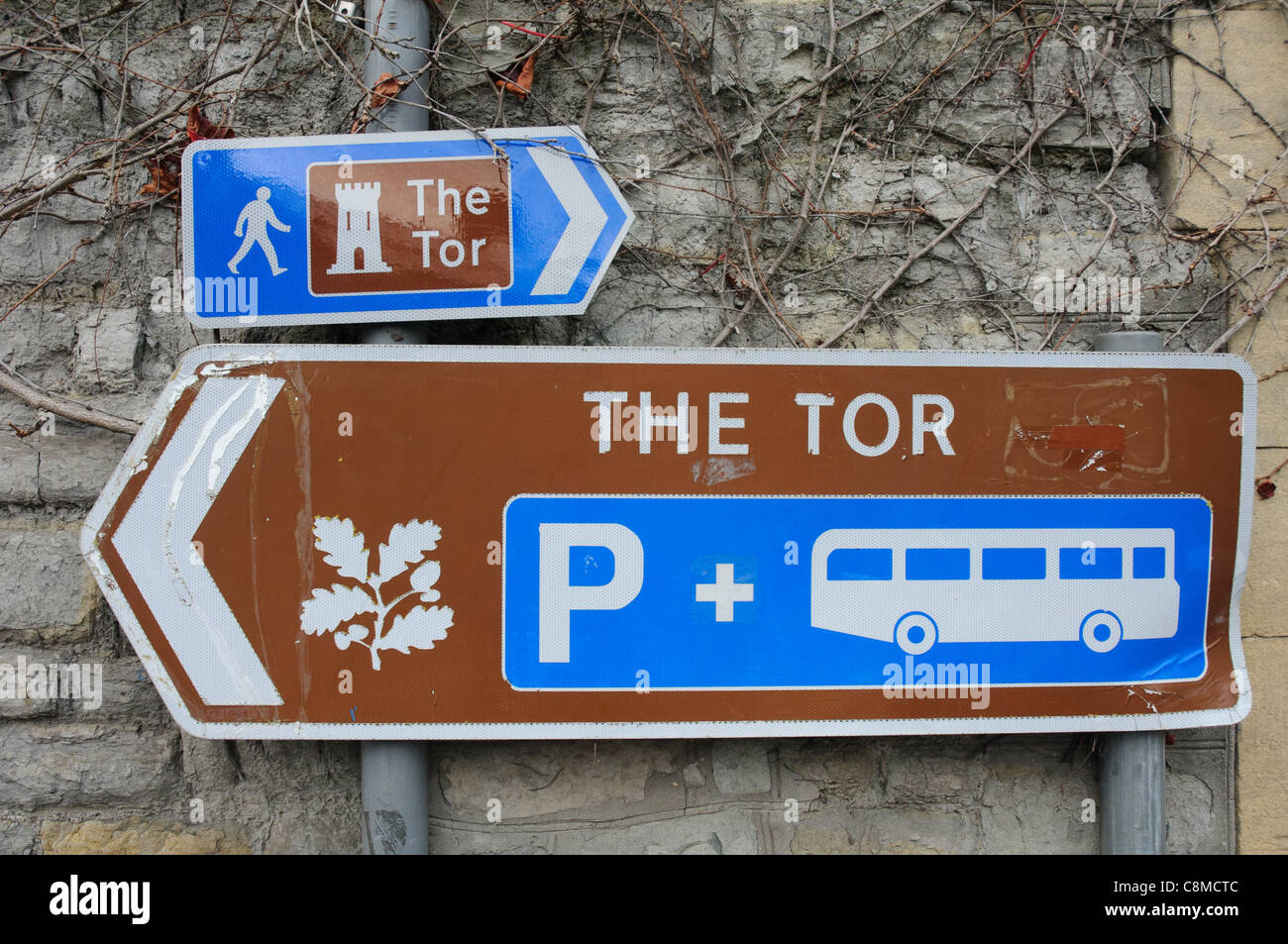 Signs pointing the way to Glastonbury Tor in Somerset England - Stock Image