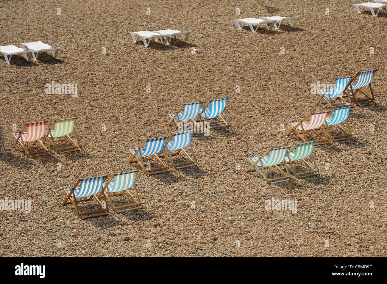 Deck chairs on a coastal beach - Stock Image