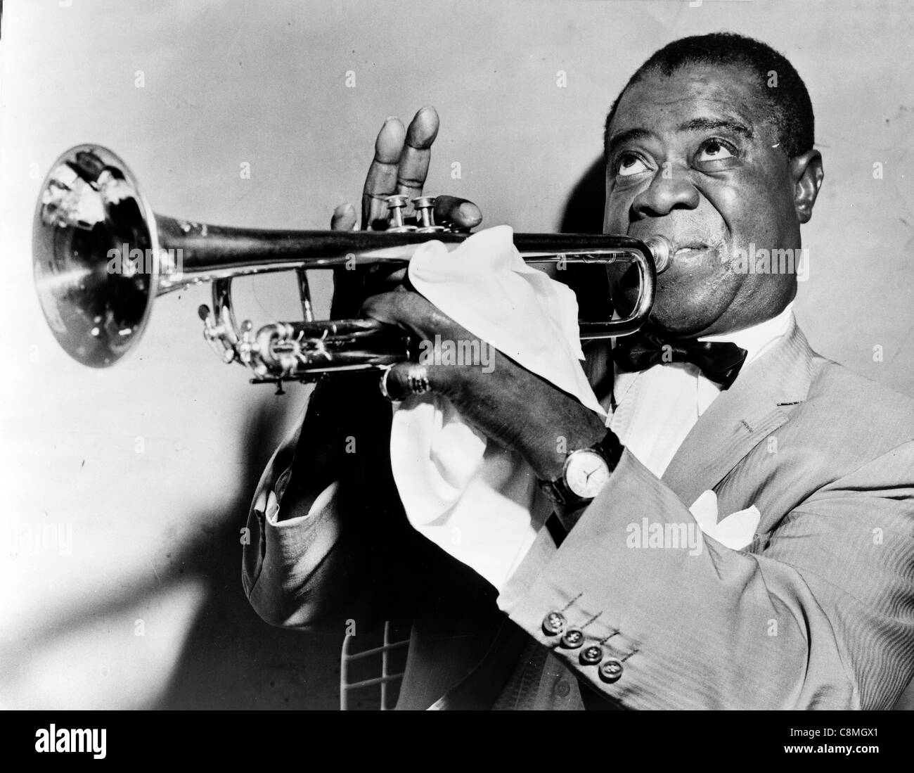 Louis Armstrong playing trumpet, American jazz trumpeter and singer from New Orleans - Stock Image