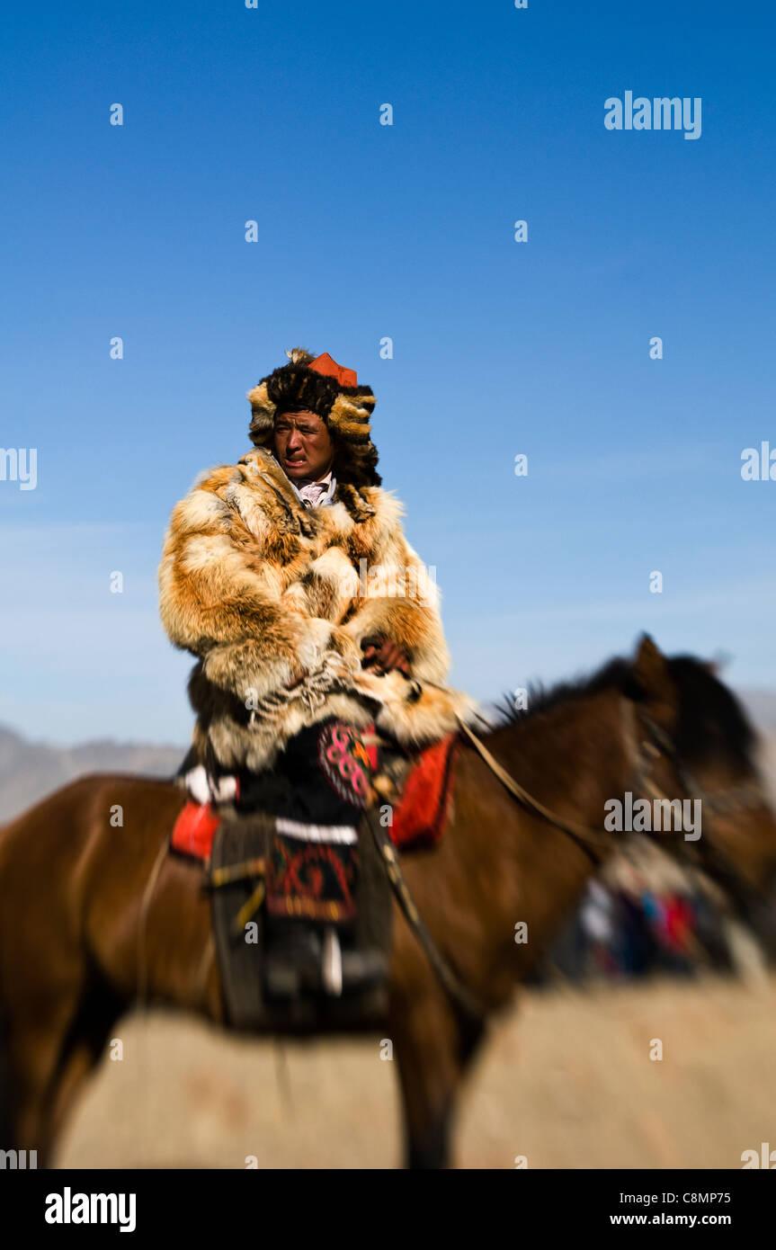 A Kazakh eagle hunter at the annual 'Eagle hunters' festival at Bayan Ölgii in western Mongolia. Stock Photo