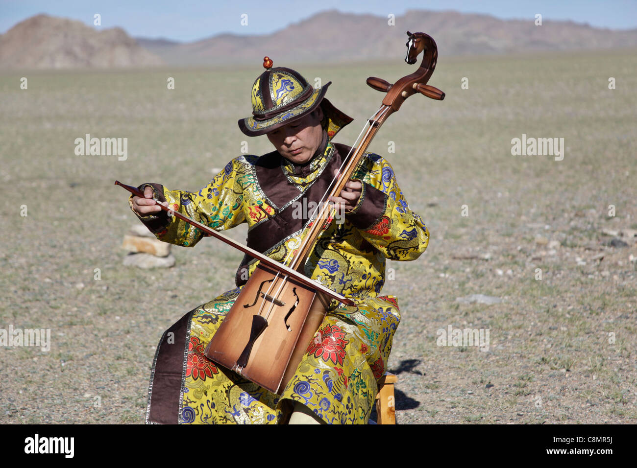 Musician playing the Morin khuur, the typical musical instrument of Mongolia - Stock Image