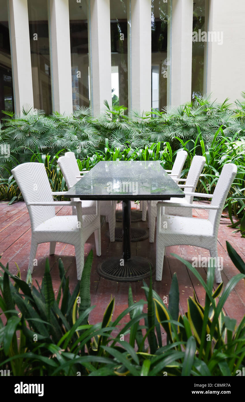 Dinning table and chairs in garden Stock Photo