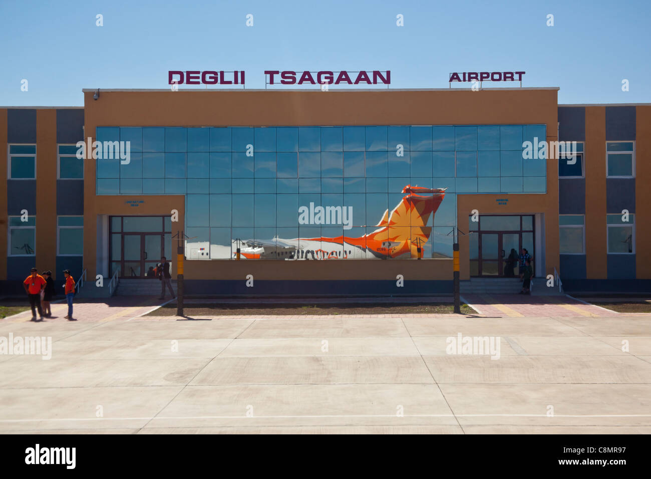 Deglii Tsagaan airport in Mongolia with plane reflected in glass terminal Stock Photo