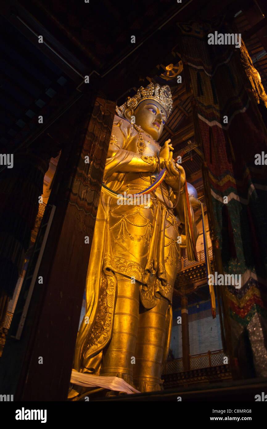 Migjid Janraisig in the Gandantegchinlen Khiid Monastery, giant golden statue in Ulaanbaatar in Mongolia. - Stock Image