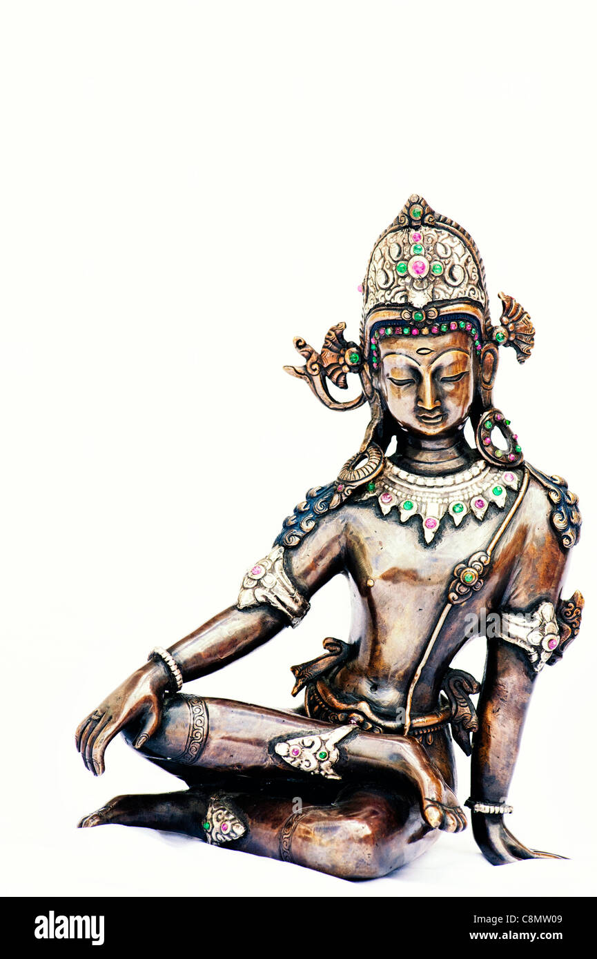 Sitting Indian deity statue on white background - Stock Image
