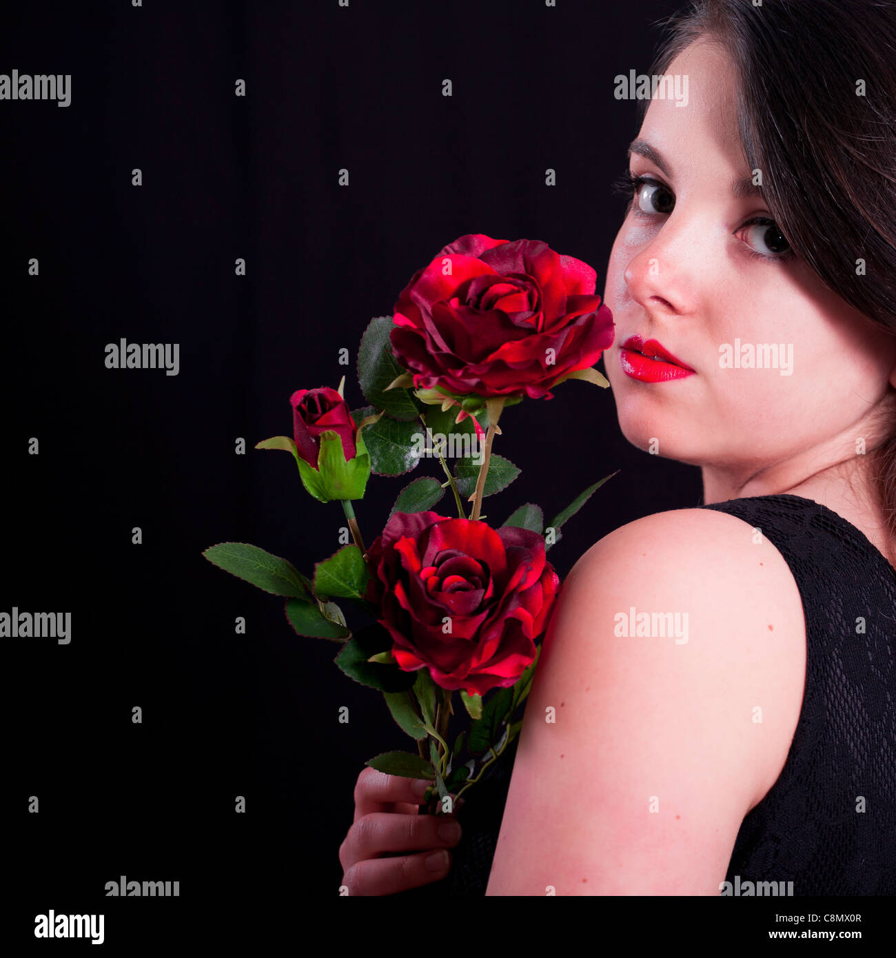 girl with red roses - Stock Image