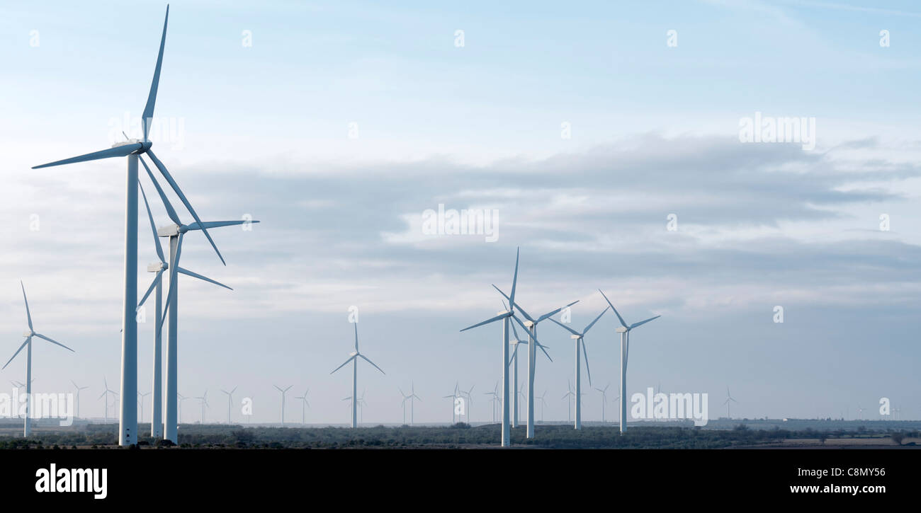 windmills for electricity production with cloudy sky - Stock Image