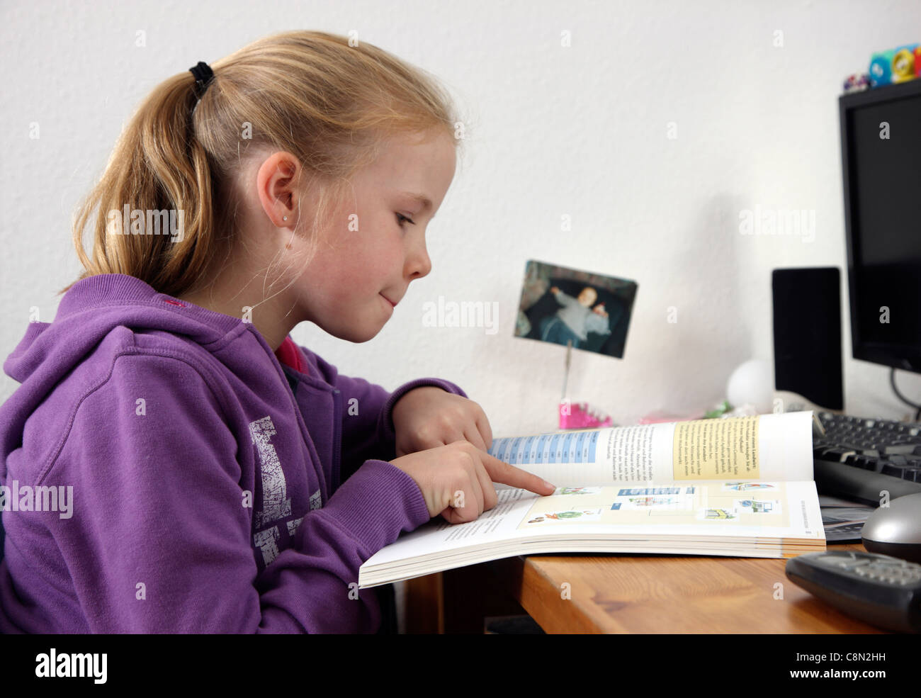 Girl, 10 years old, learning for school, at home in her room, doing homework. Stock Photo