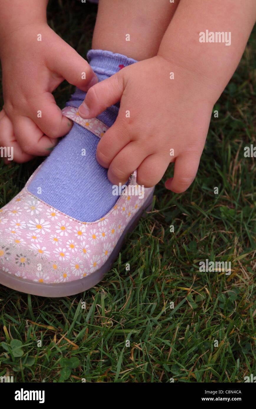Girl Putting Socks High Resolution