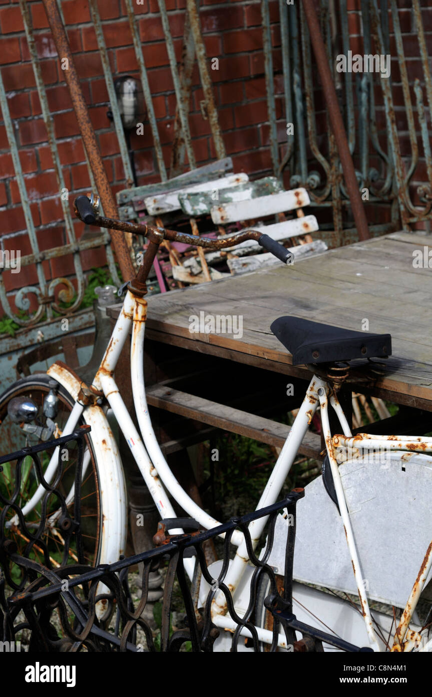 scrap metal waste yard breakers recycle reclaim bedstead bike bicycle wrought iron reuse - Stock Image