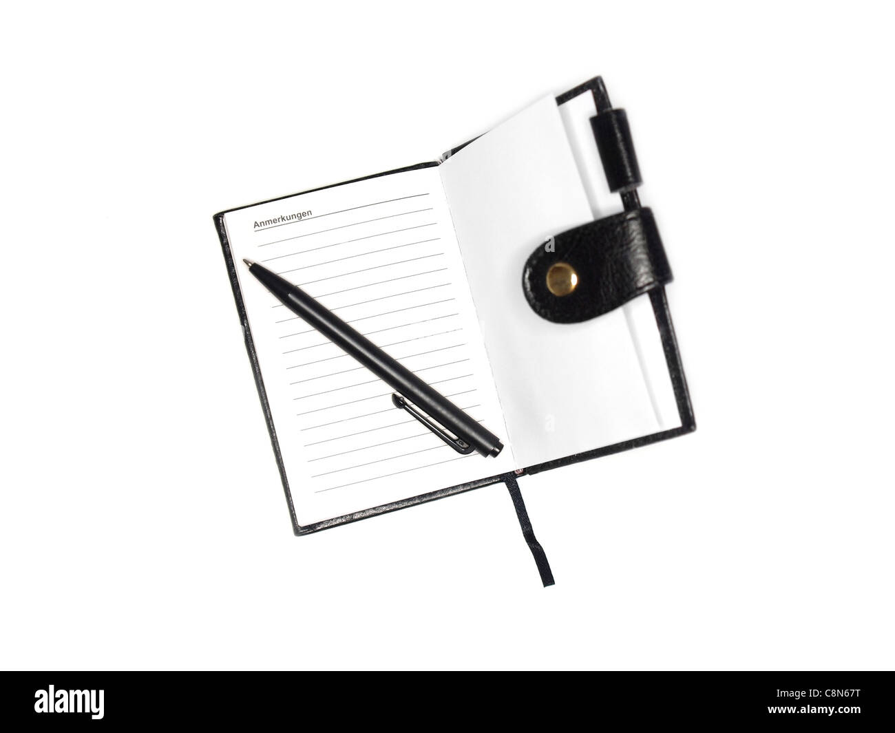 old-fashioned note book with pen, isolated on white - Stock Image