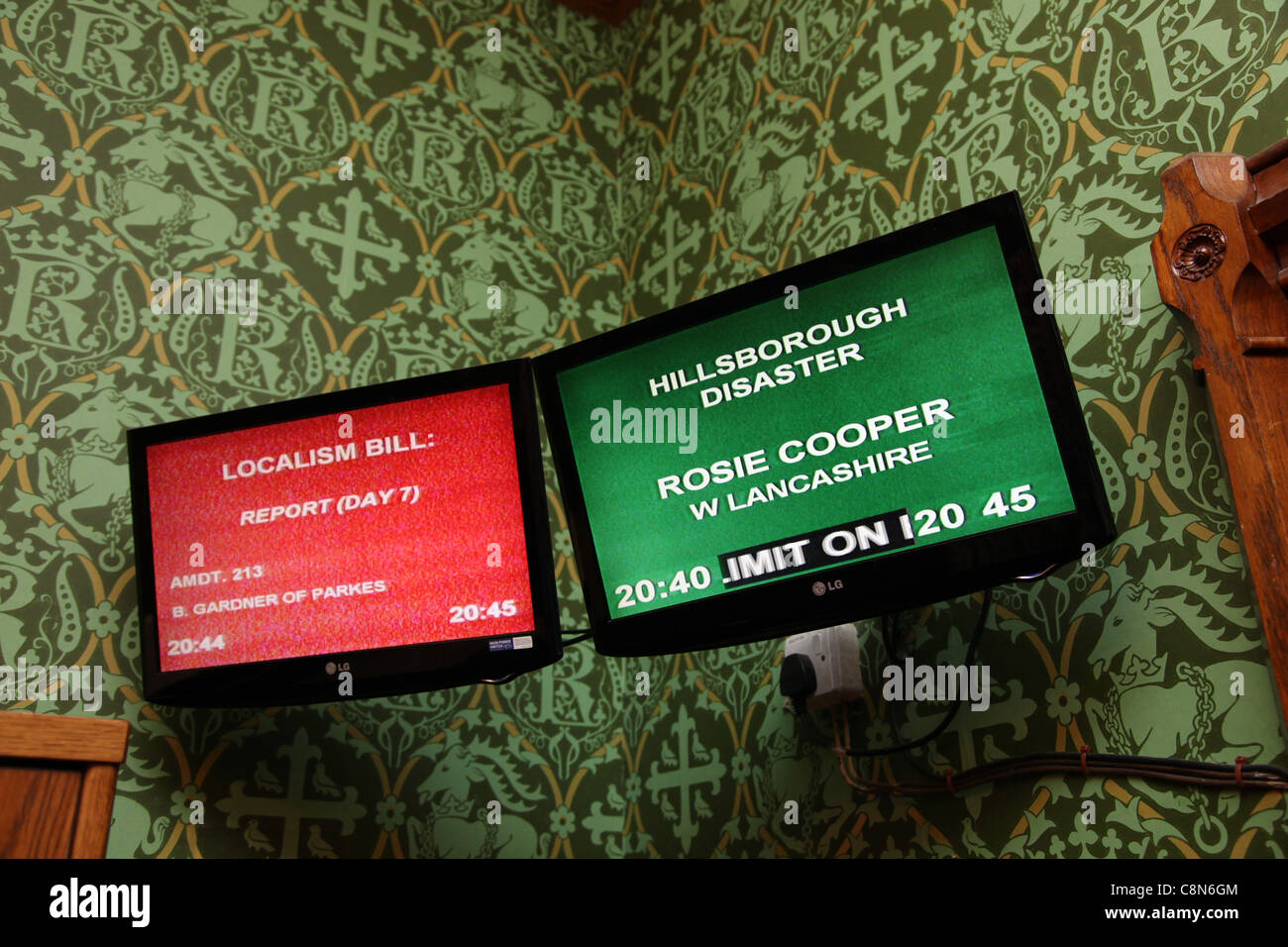 Television screens in the House of Lords relaying information about debates in the House of Lords and the House - Stock Image