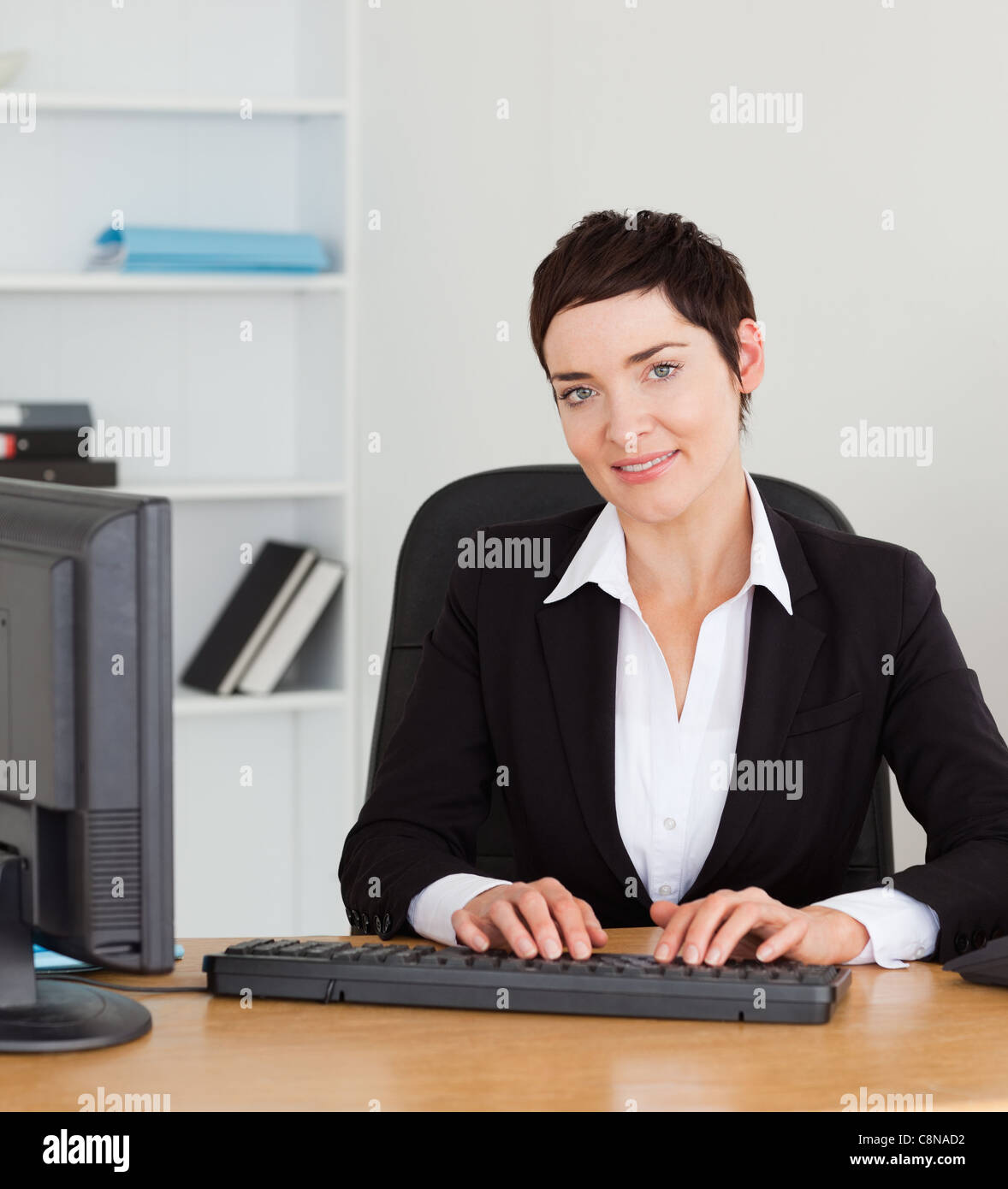 Portrait of a secretary typing on her keybord - Stock Image