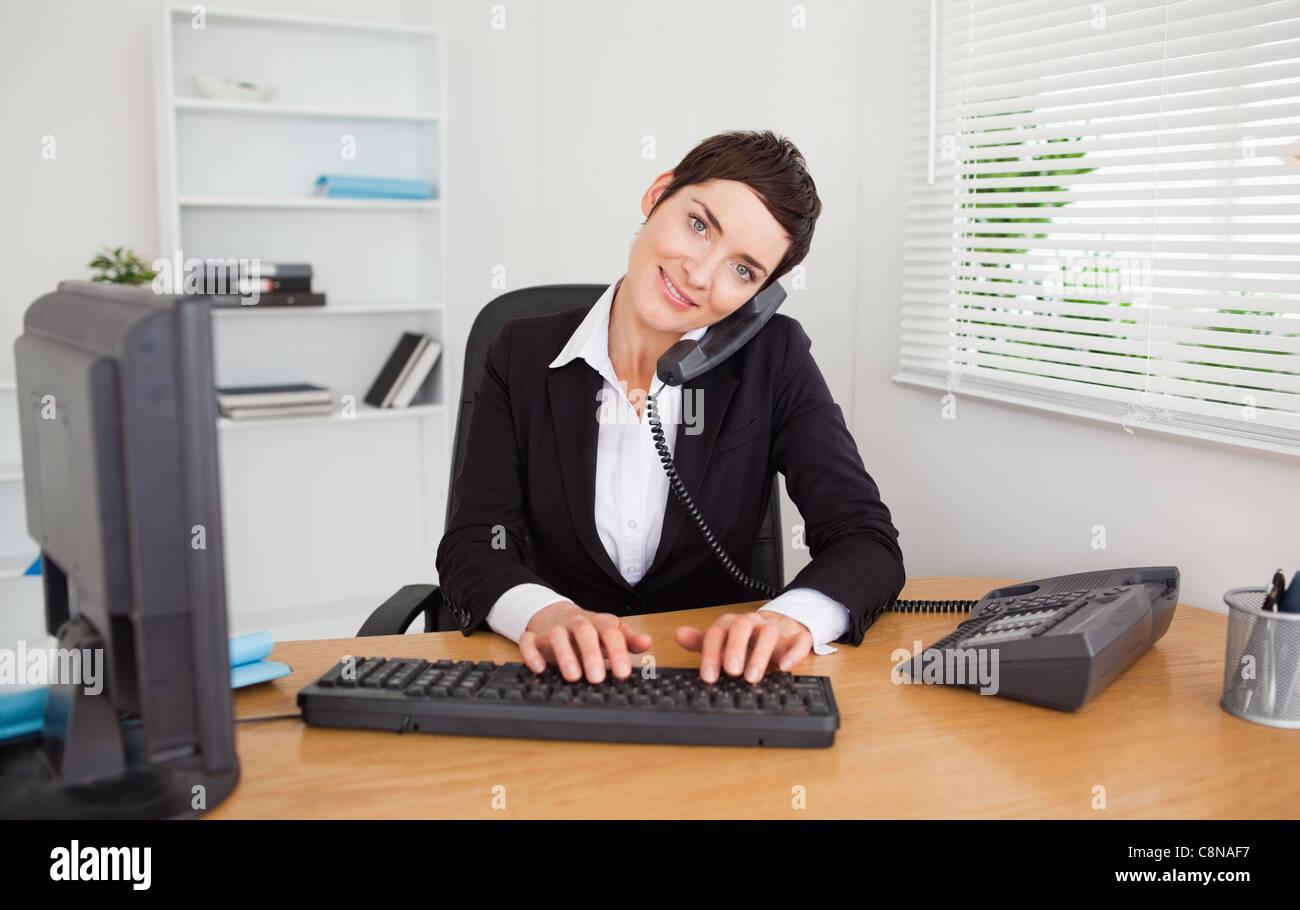 Professional secretary answering the phone - Stock Image