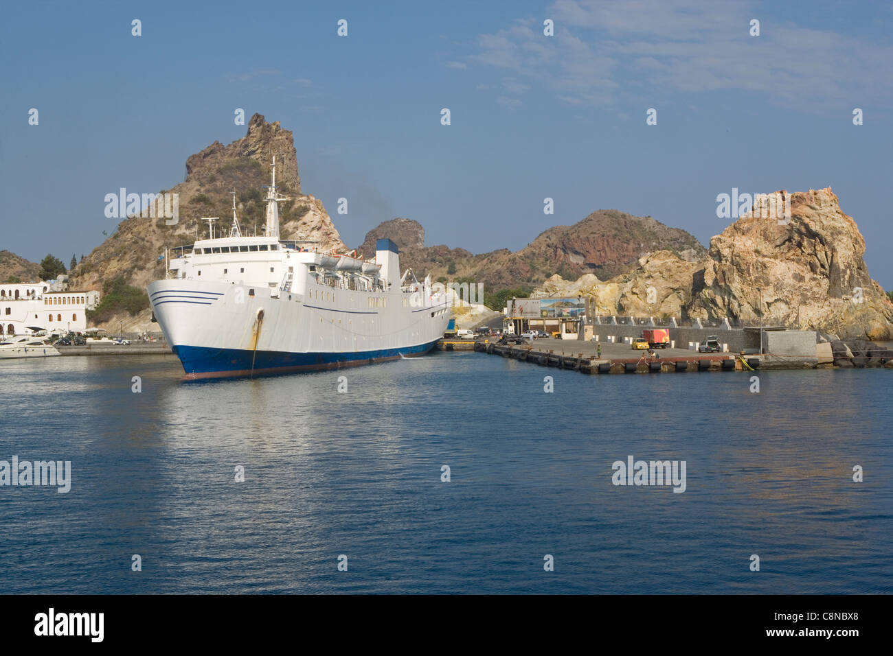 Italy, The Aeolian Islands, ferry by the rocky shore - Stock Image
