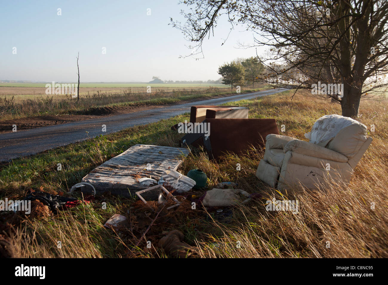 Fly tipped rubbish at the side of a rural road in Cambridgeshire - Stock Image