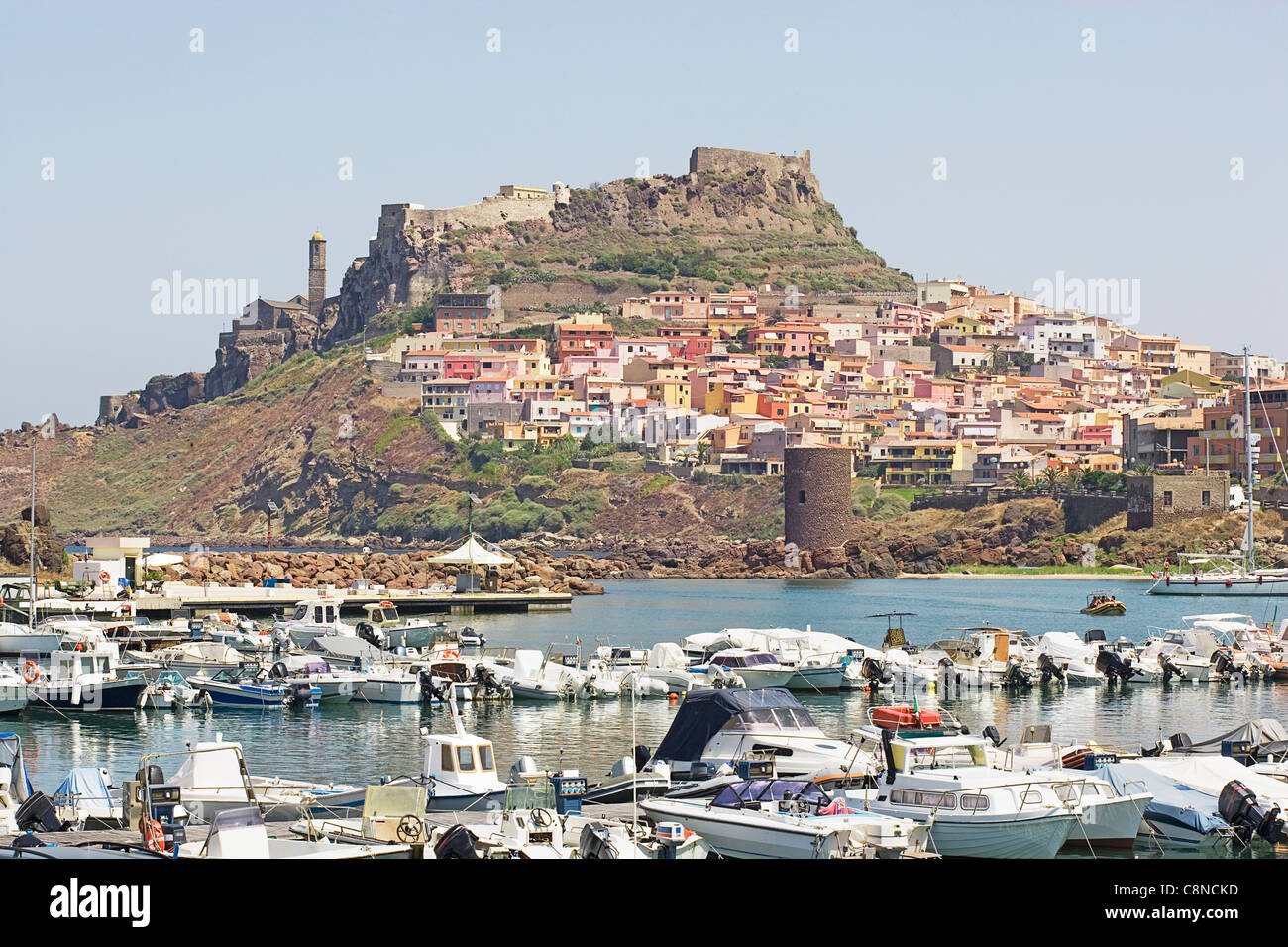 Italy, Sardinia, Castelsardo, view of medieval town and fortress on hilltop across the port Stock Photo