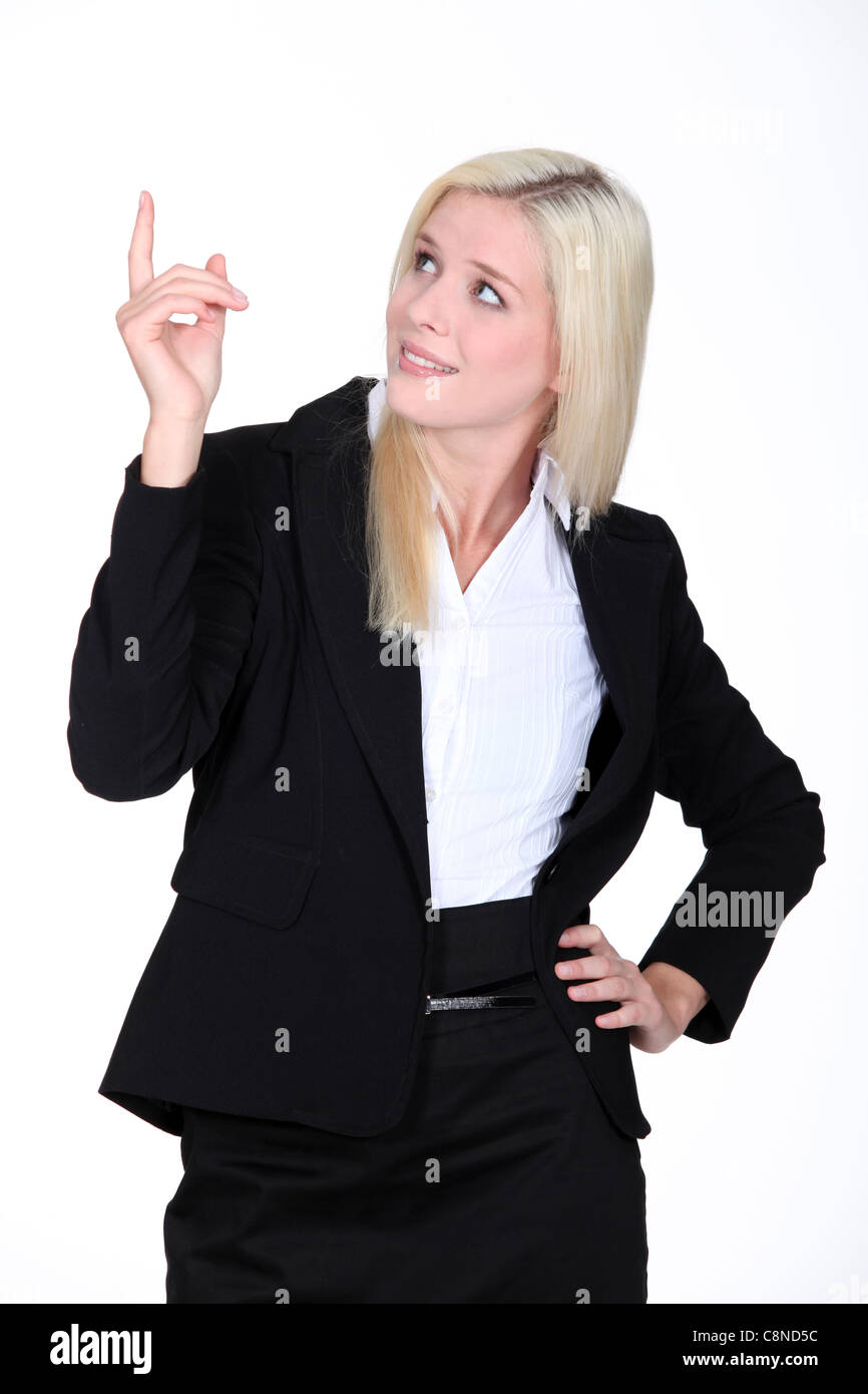 Businesswoman pointing her finger upwards Stock Photo