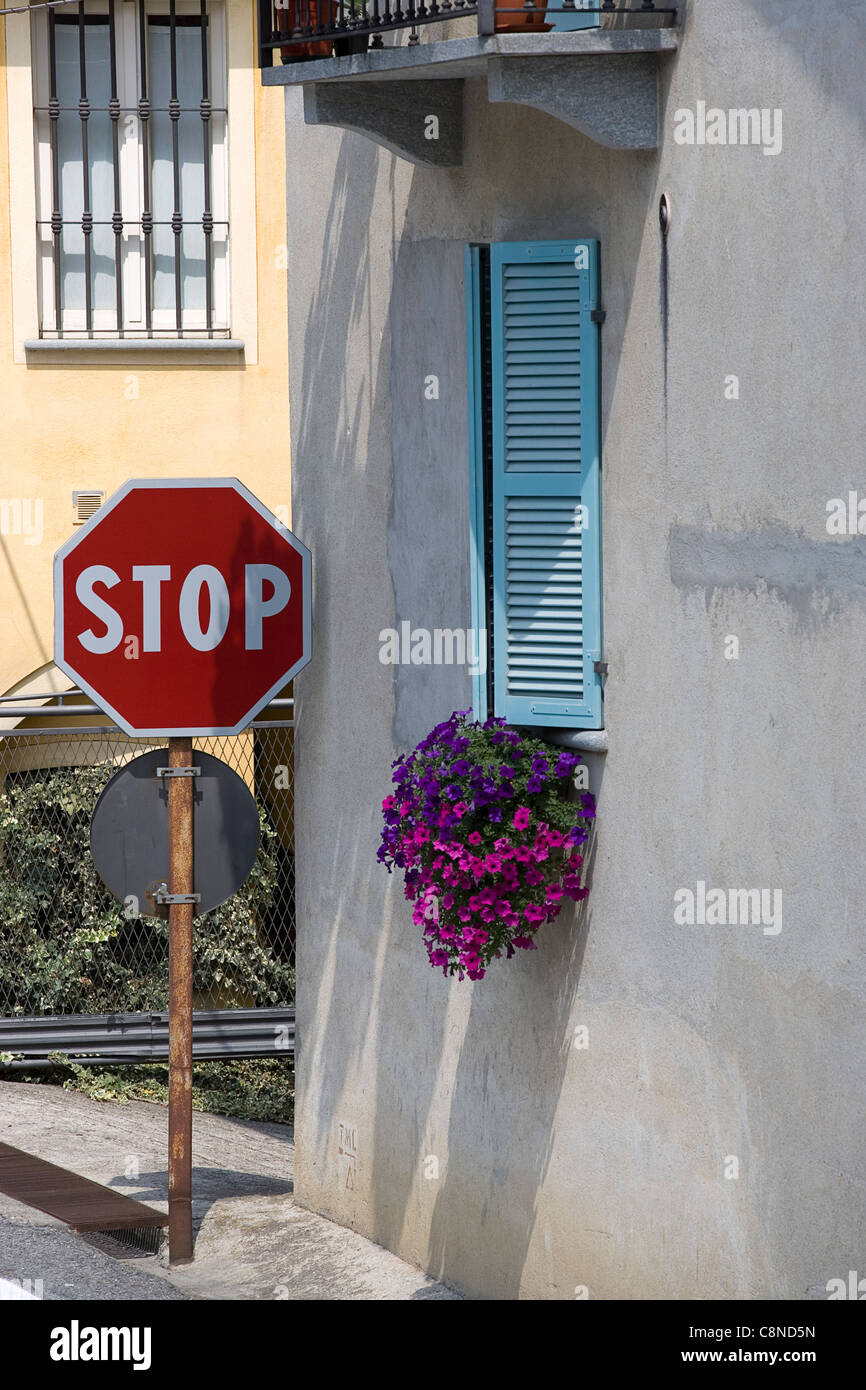 Italy, Piemonte, Barolo, stop sign next to window with window box outside - Stock Image