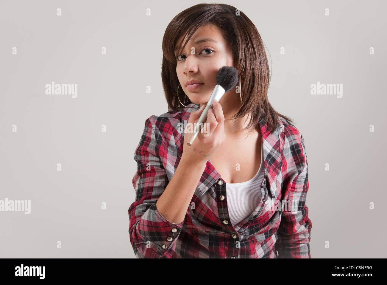 Black Girl Putting On Makeup