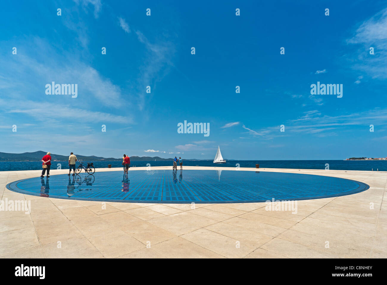 At the very end of the Zadar peninsula, shines the Greeting to the Sun made by the architect Nikola Basic, Croatia, - Stock Image