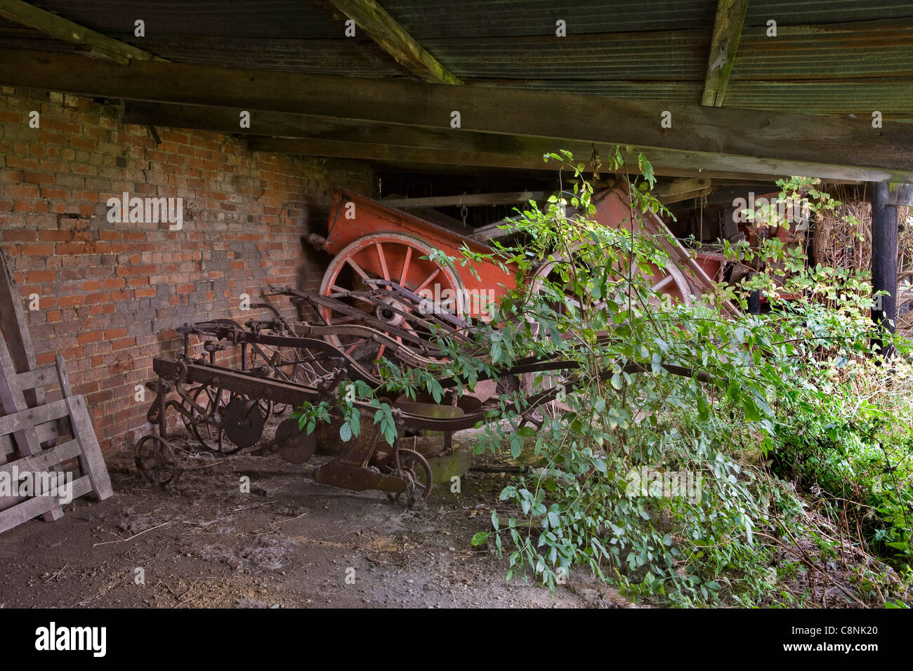 Horse drawn farm carts and ploughs - Stock Image