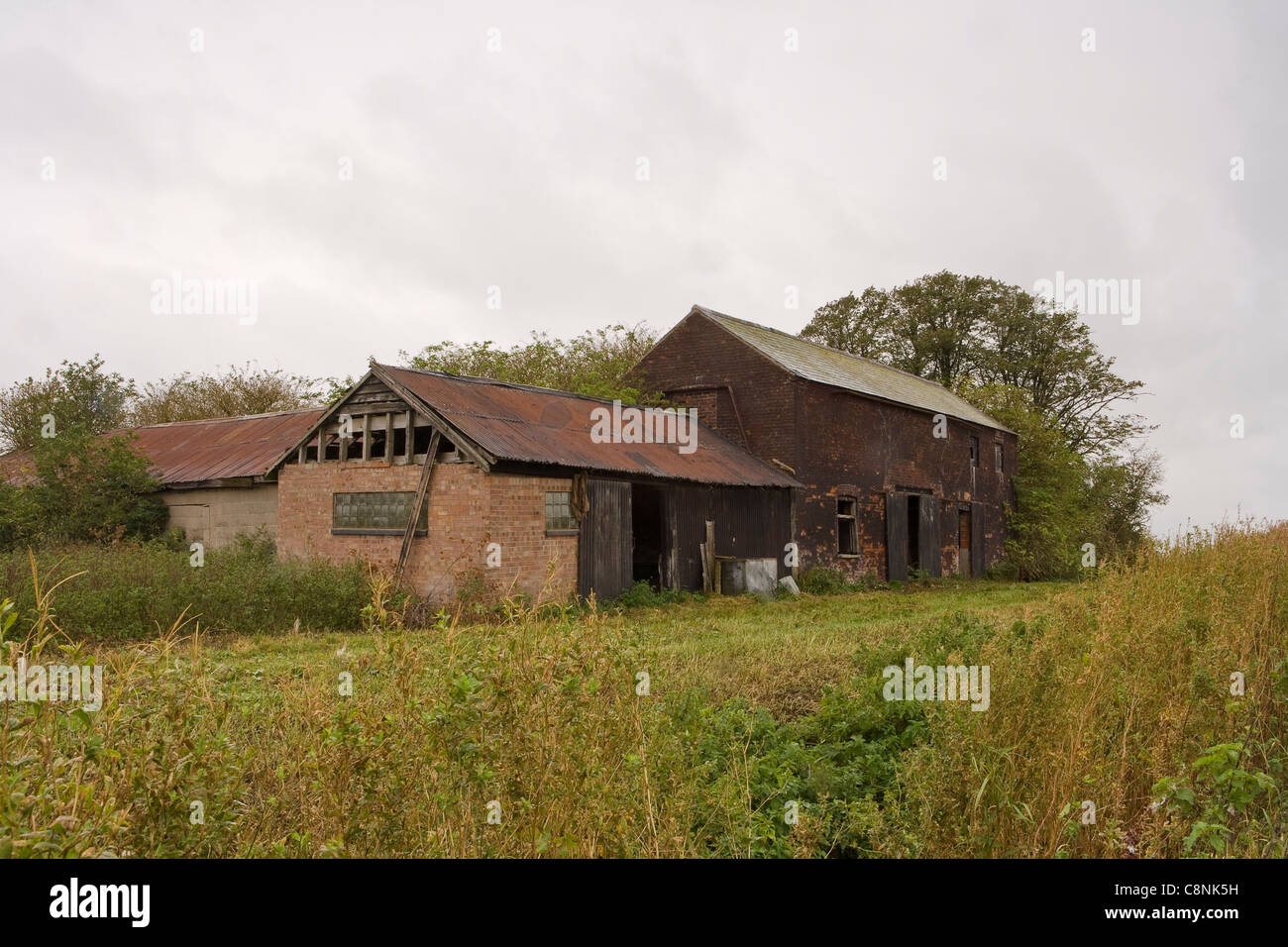 Redundant farm buildings left behind by the progress in farming methods. - Stock Image