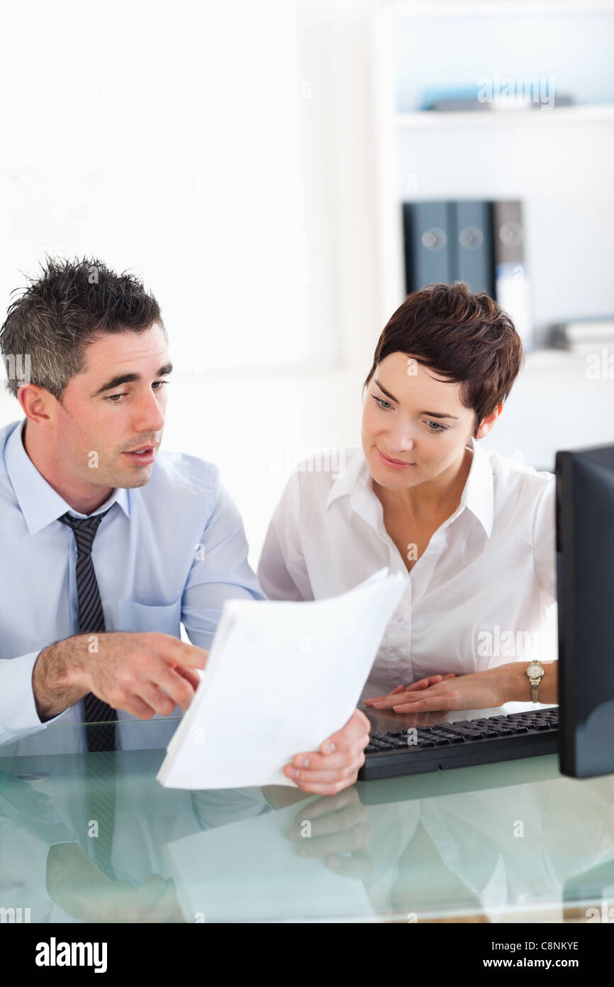 Portrait of colleagues looking at documents - Stock Image