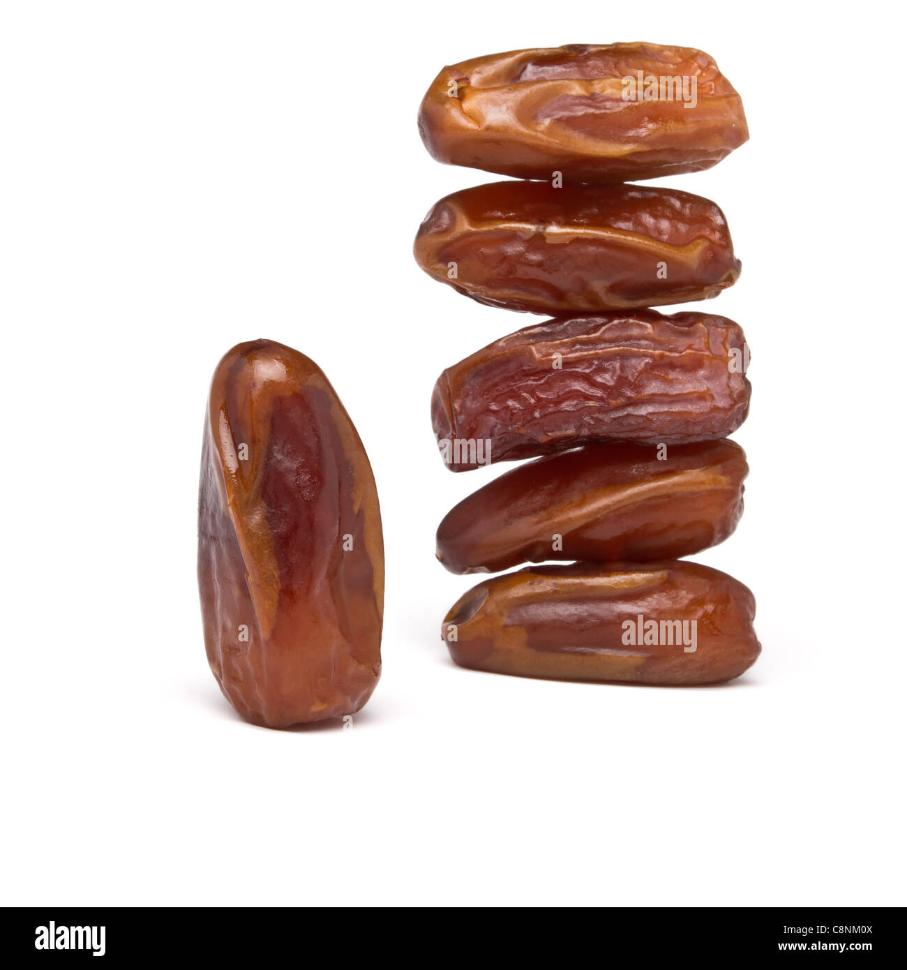 Abstract stack of date fruits on white background. - Stock Image
