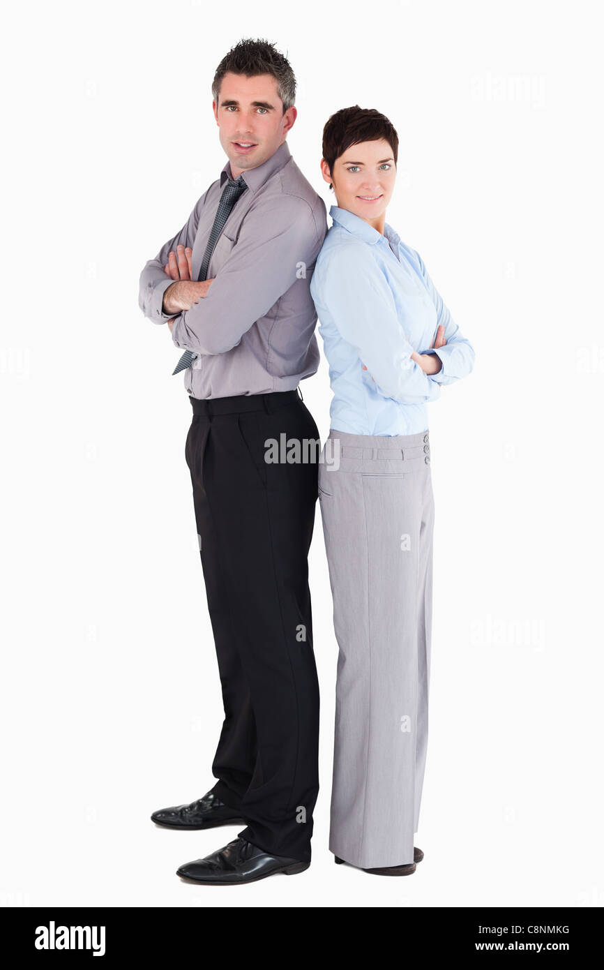 Office workers standing up back to back - Stock Image