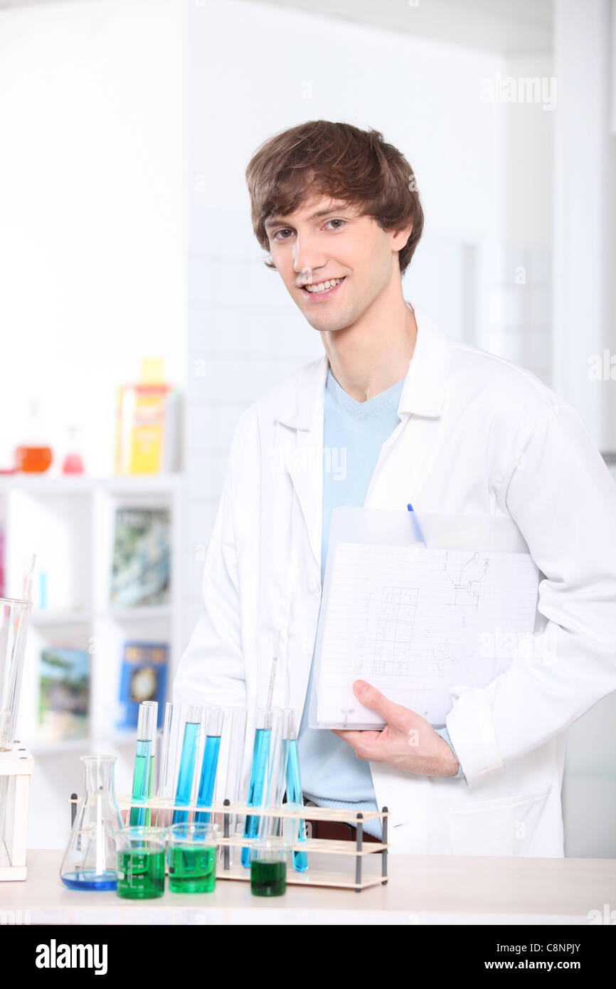 Young man in science laboratory - Stock Image