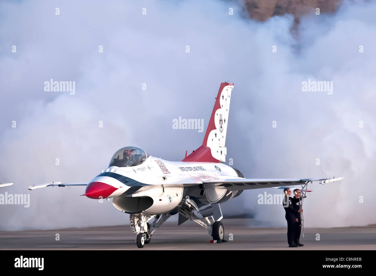 Maj. Rick Goodman, lead solo with the Air Force Air Demonstration Squadron, the Thunderbirds, releases smoke and - Stock Image