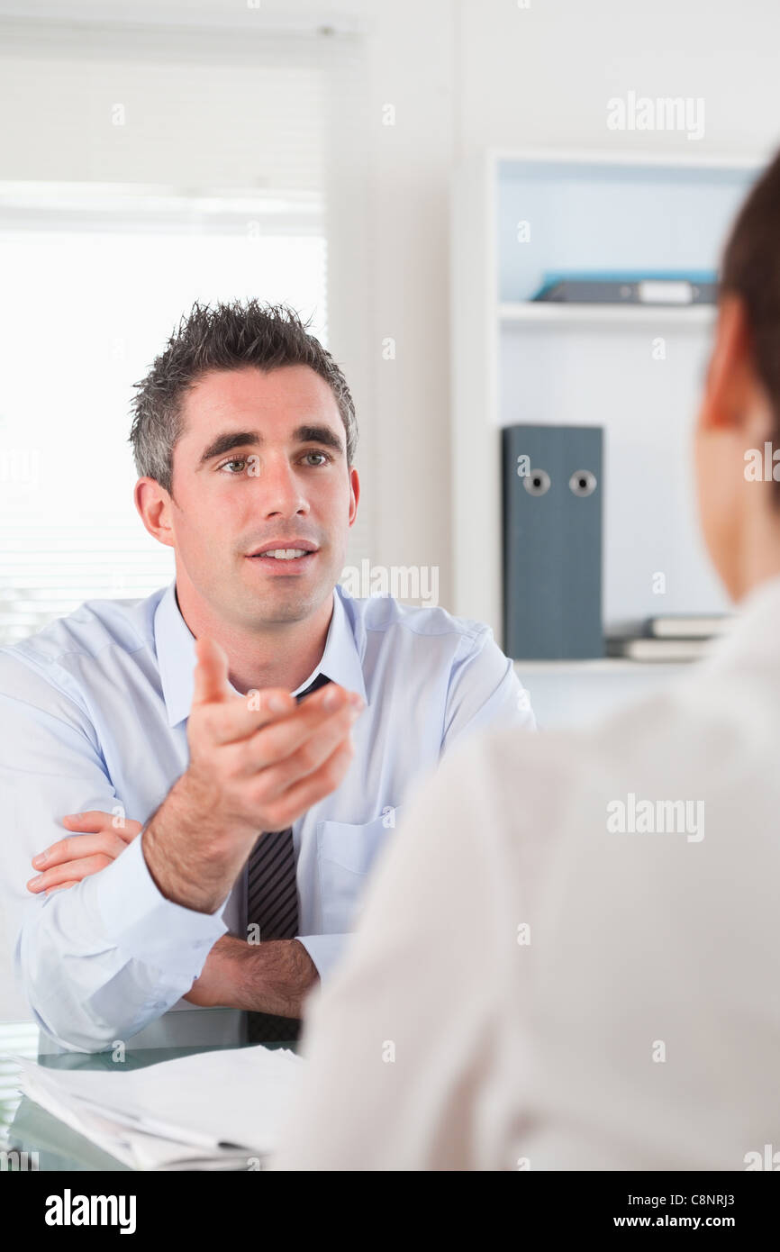 Portrait of a manager talking to a candidate - Stock Image