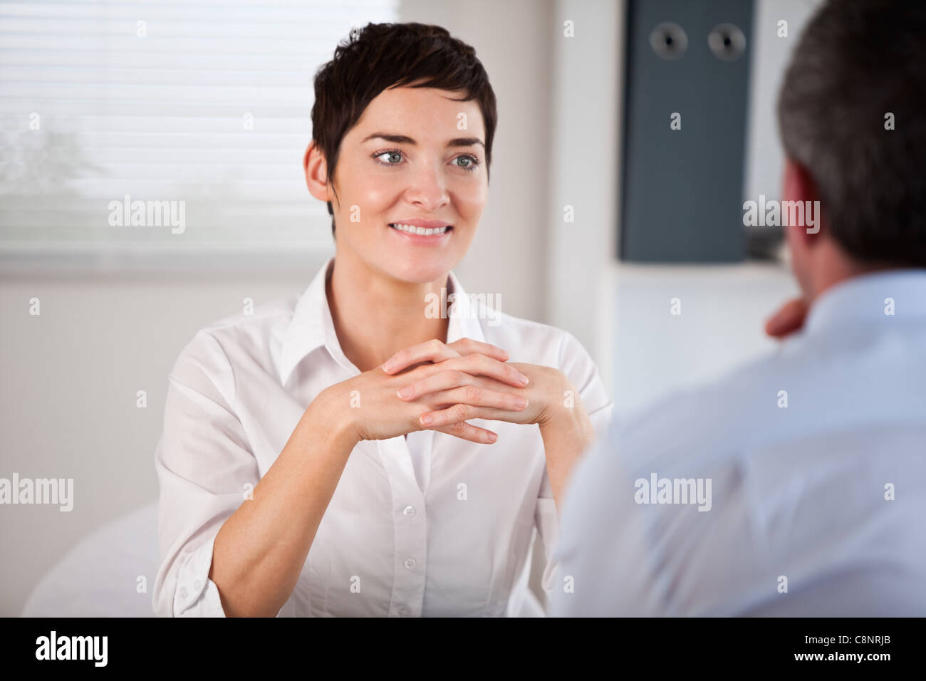 Candidate listening to her future manager - Stock Image