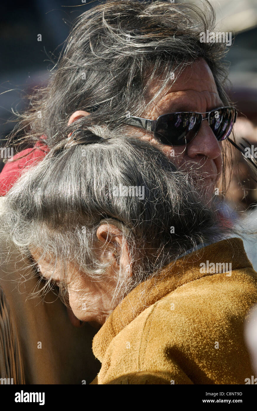 Two Elders of the First Nations comforting each other. - Stock Image
