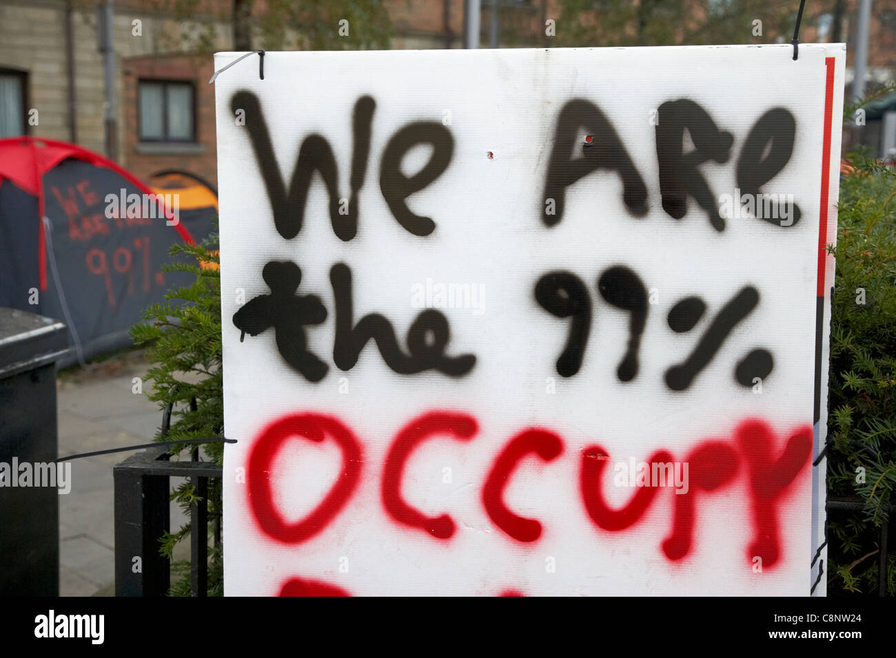 We are the 99% occupy belfast anti capitalist tented protest in writers square belfast northern ireland uk - Stock Image