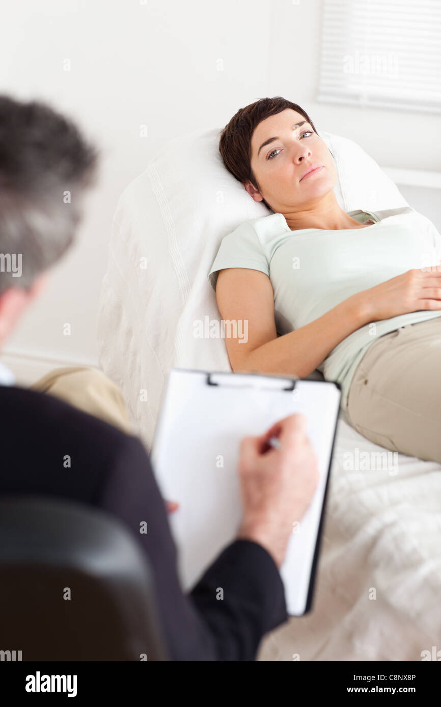 Psychologist talking to a sad female patient Stock Photo