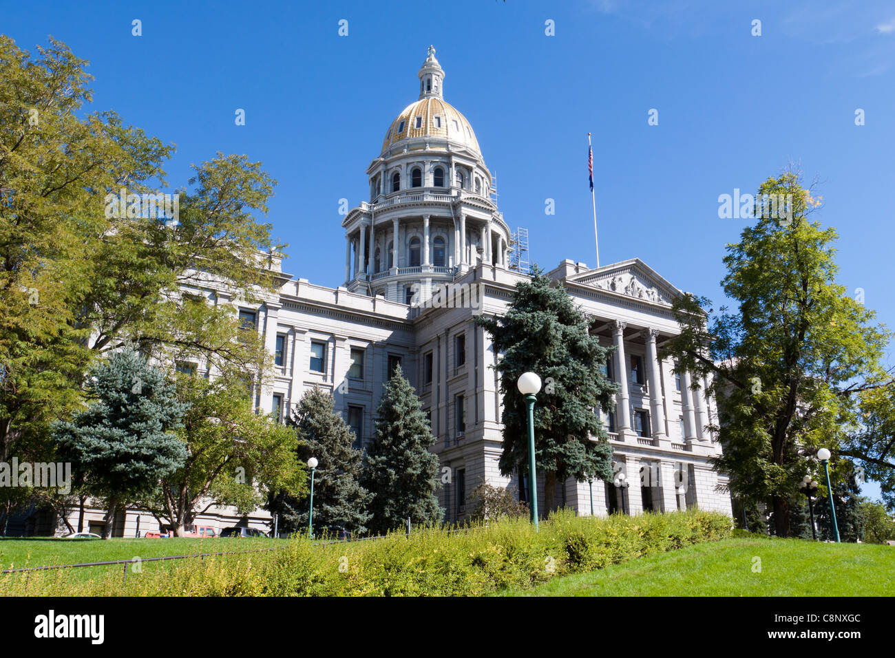 Front of the Colorado state capitol building with gold dome taken from side lawn, in Denver. - Stock Image