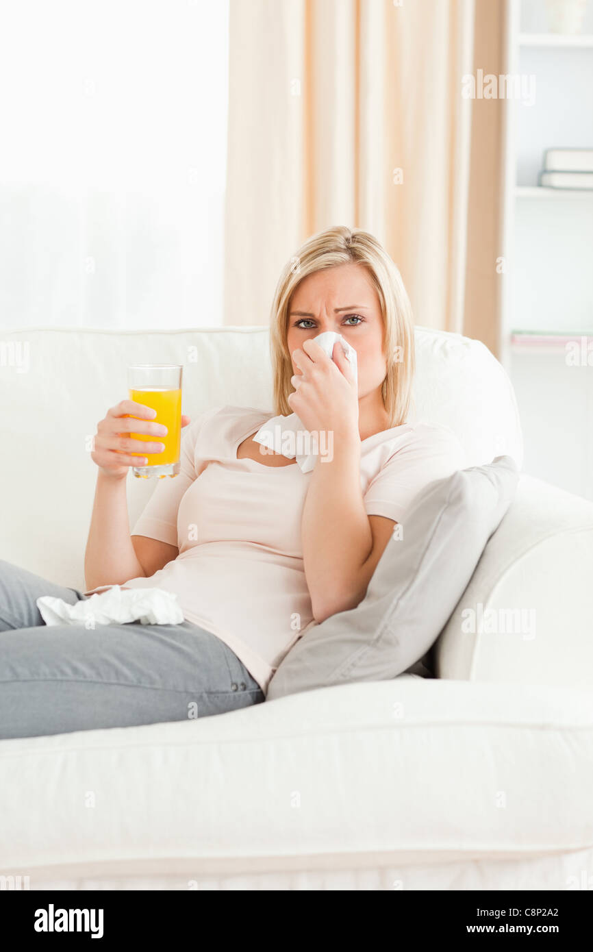 Sick blond-haired woman - Stock Image