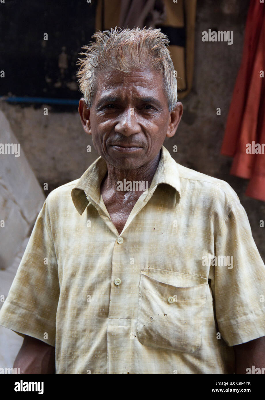 Stall owner in the famous Chandni Chowk market in New Delhi, India - Stock Image
