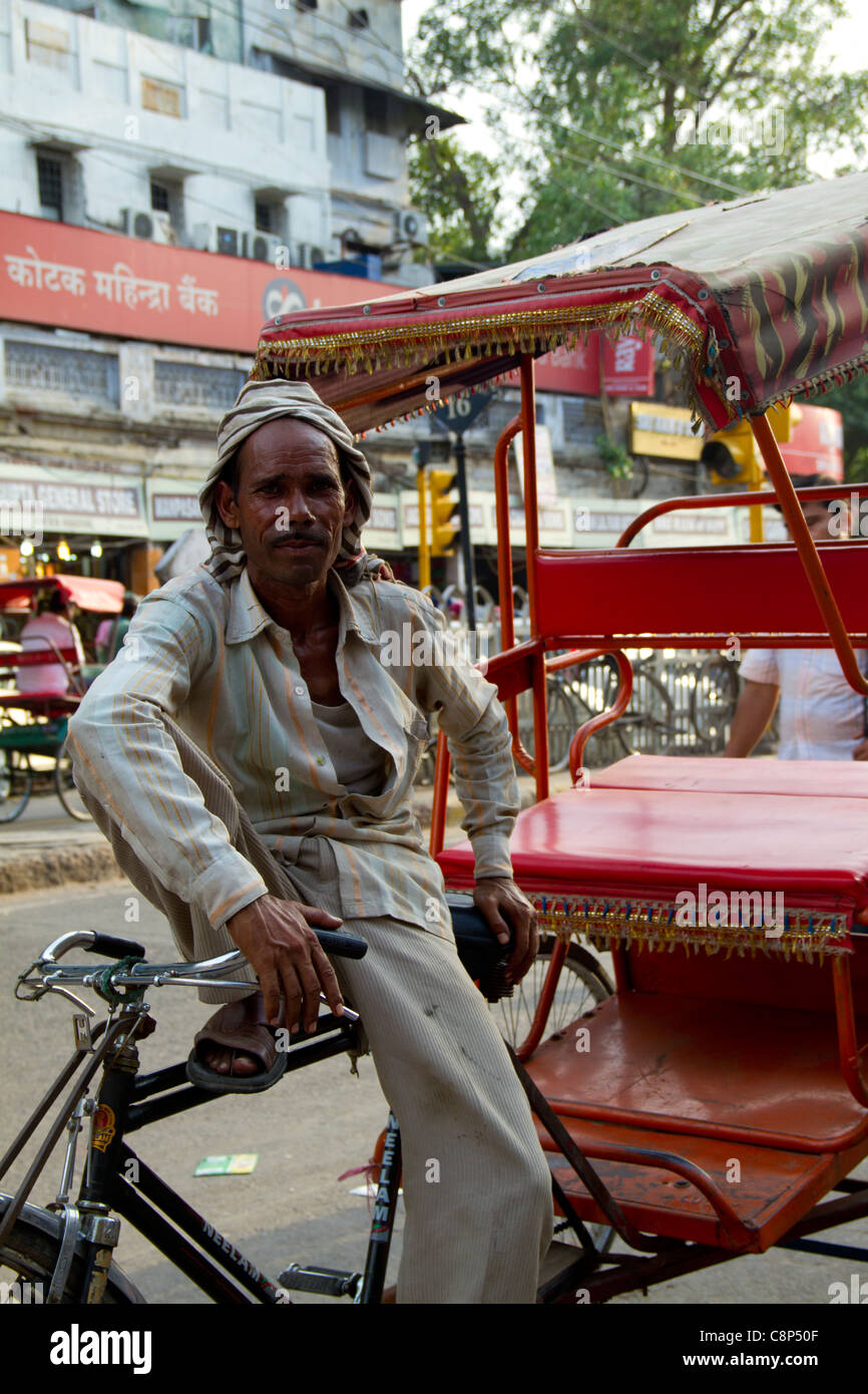 man waiting for customers to ride on his rickshaw - Stock Image