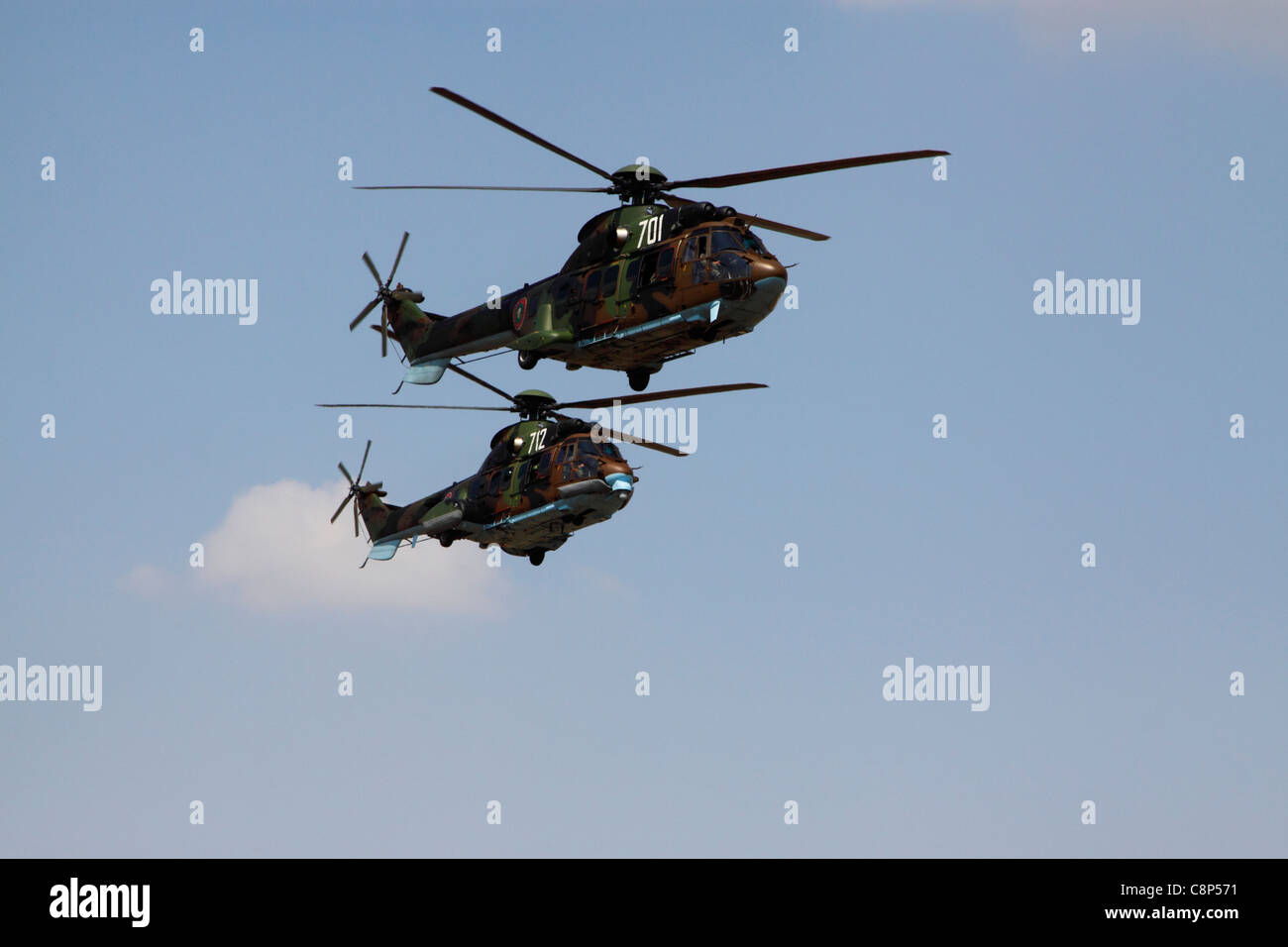 Two Bulgarian Air Force Aerospatiale AS532 Cougar medium utility helicopters in flight, blue sky in background - Stock Image