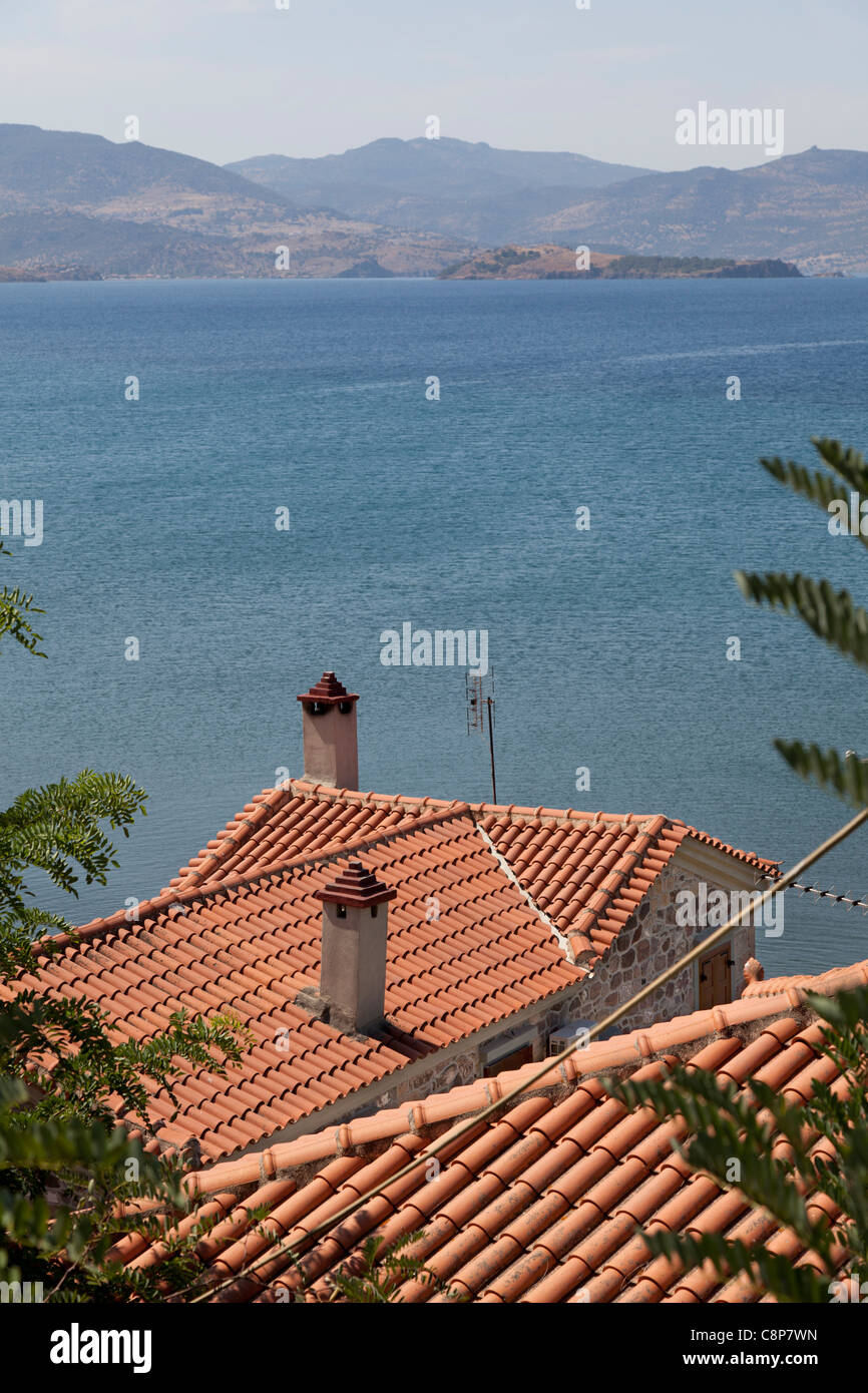 Terracota tiled rooftops at the coast of Lesbos - Stock Image