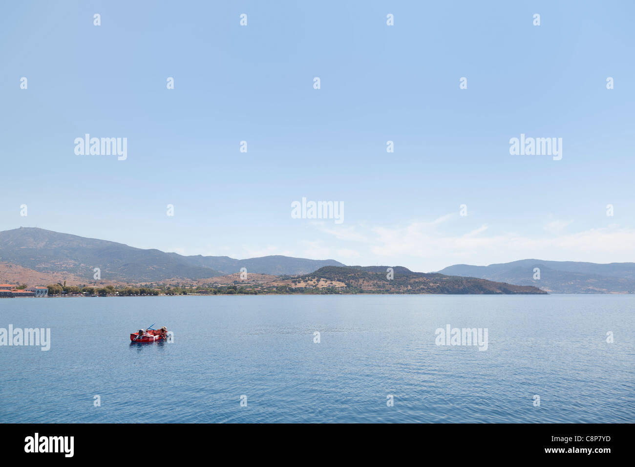 Fisherman at the clear coast of Lesbos, Greece - Stock Image