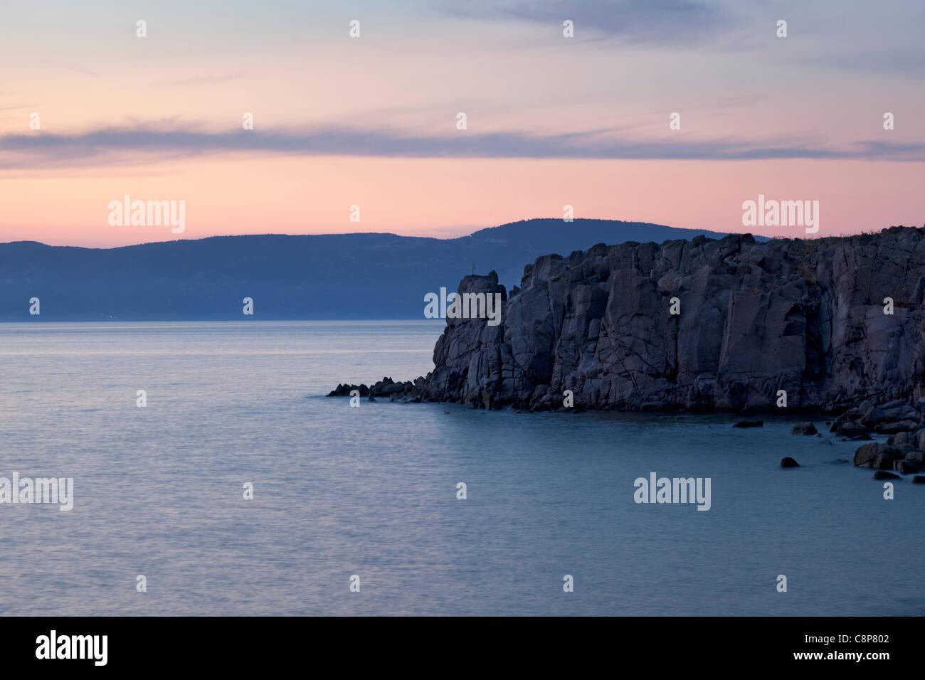 Coast of Lesbos, Greece, at sundown - Stock Image