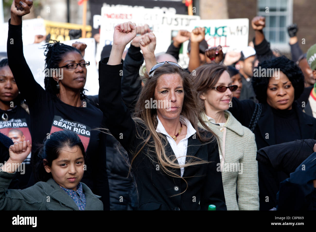 London, UK, 29/10/2011. NCAPV Protesters with their fists in the air in the manner of a 'Black power salute' - Stock Image