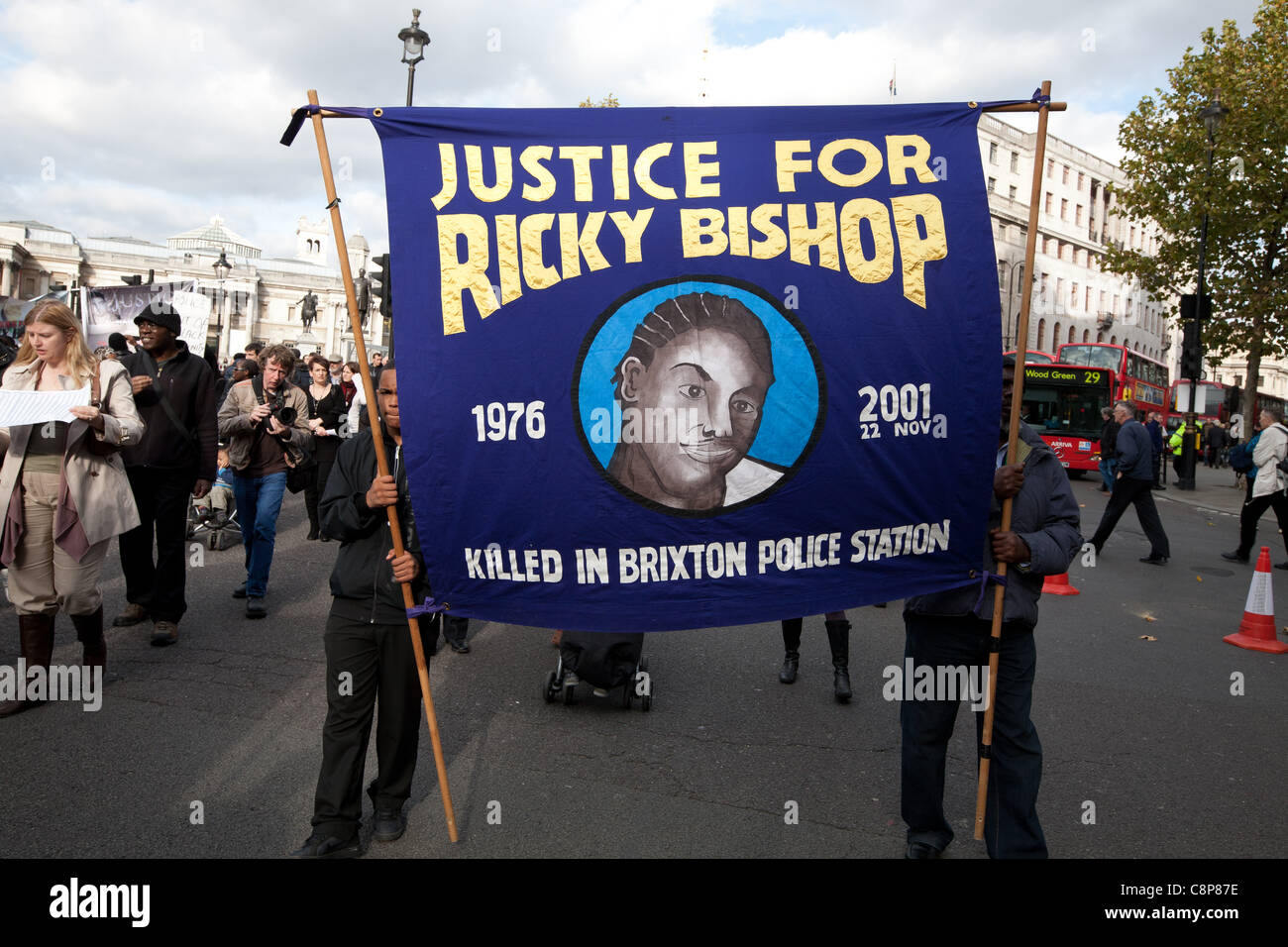 London, UK, 29/10/2011. 2 Protesters marching to Downing St holding a banner asking for justice for Ricky Bishop - Stock Image