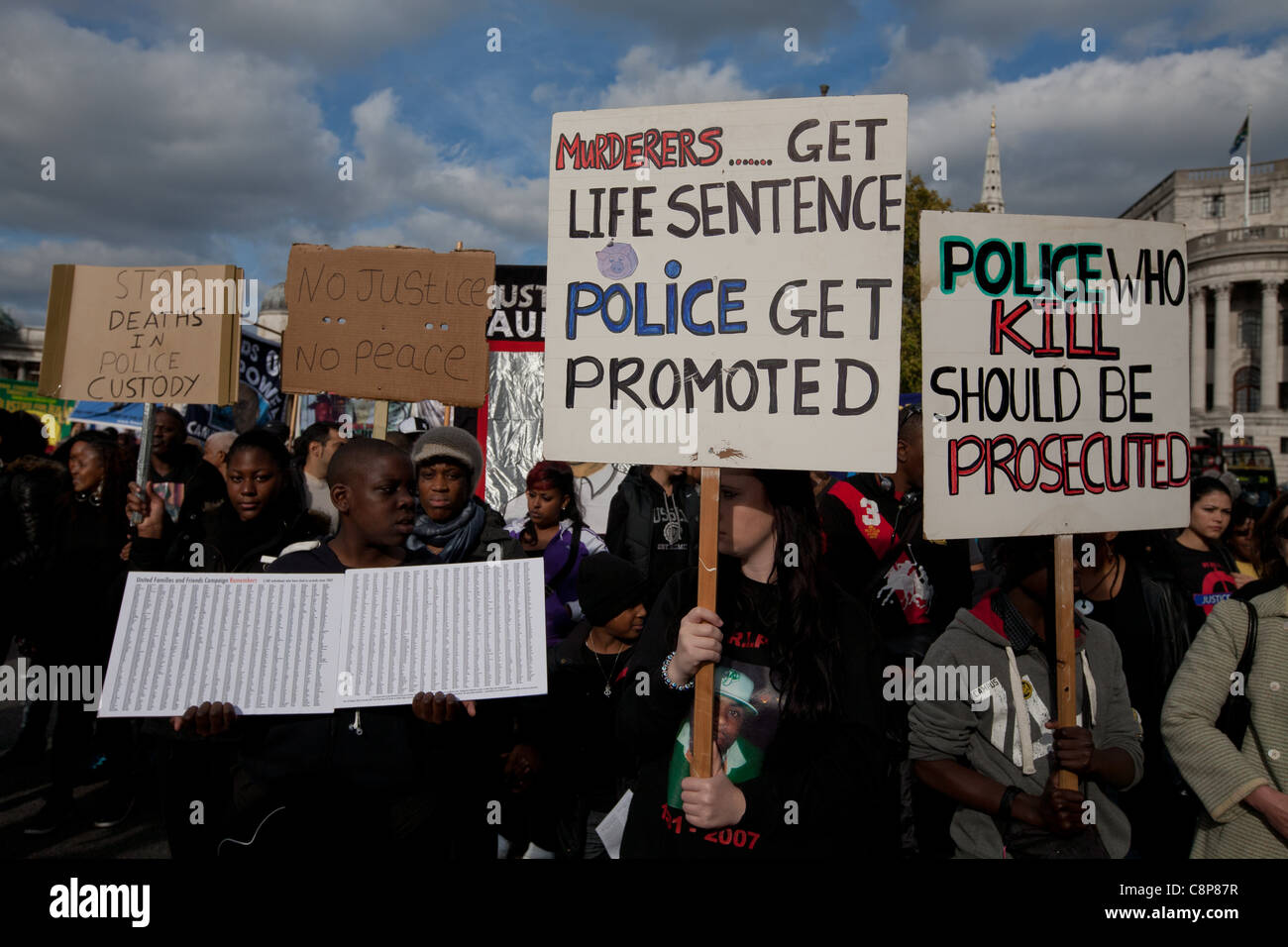 London, UK, 29/10/2011. NCAPV Protesters marching to Downing St holding banners with slogans against the police. - Stock Image