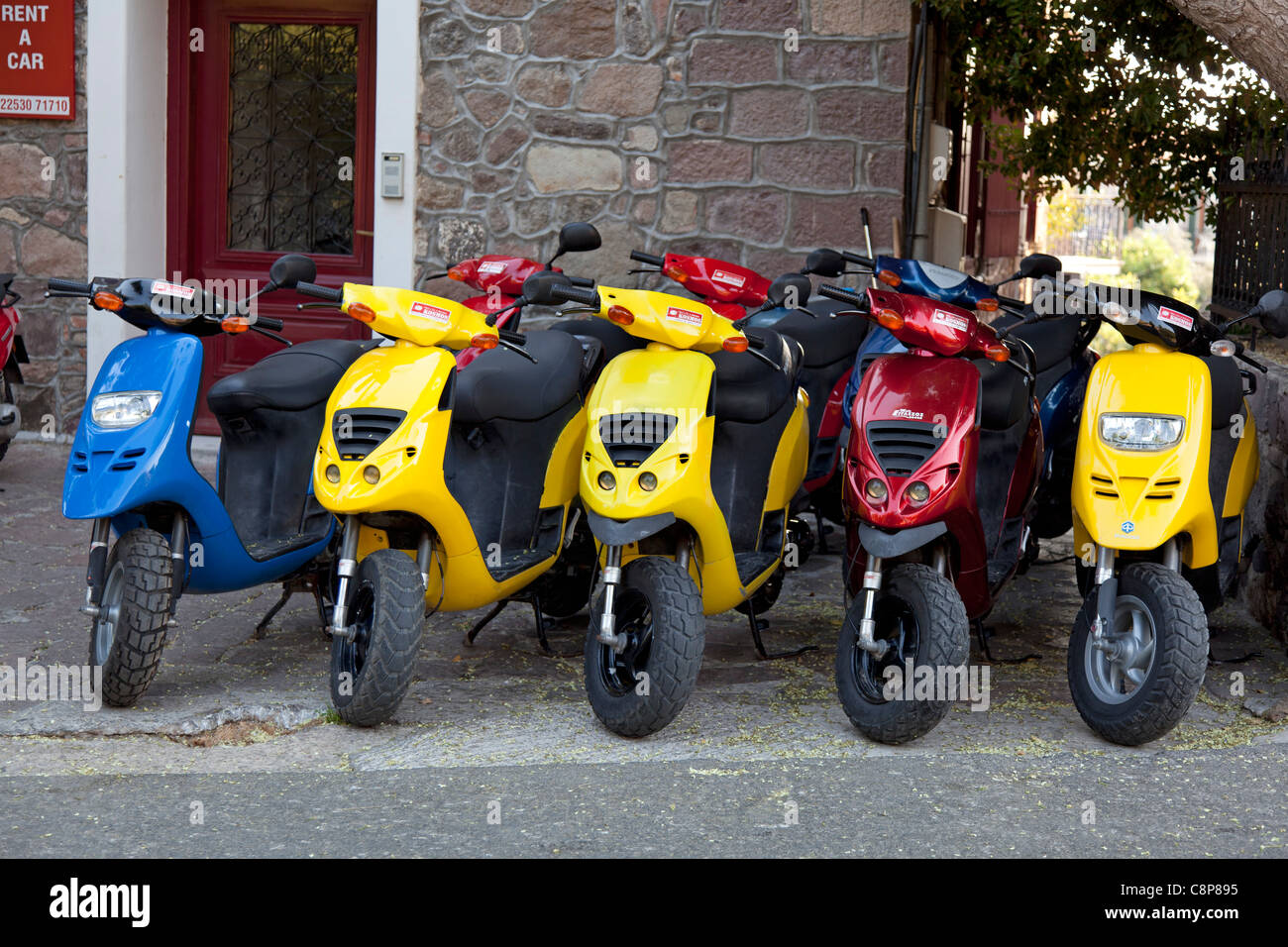 Scooters for rent in Mithymna, Lesbos , Greece - Stock Image