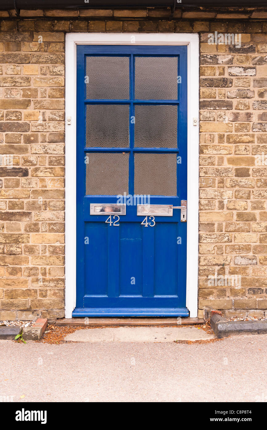 A front door with two letter boxes for different addresses in the Uk Stock Photo